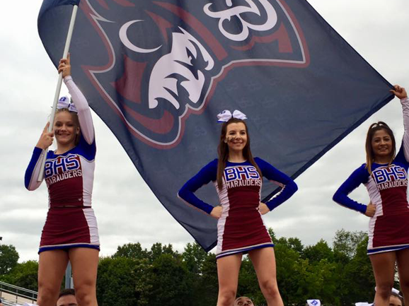 captains flag with cheerleaders