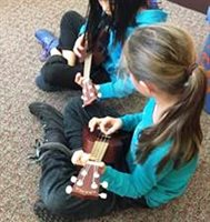 Student Playing Ukulele at Butler School