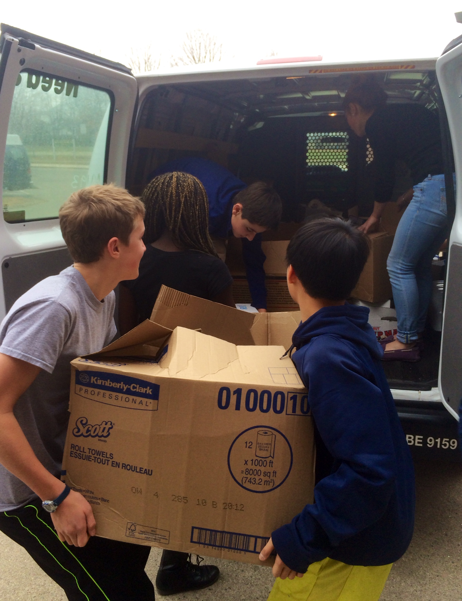 Chenery students loading boxes into trucks for delivery