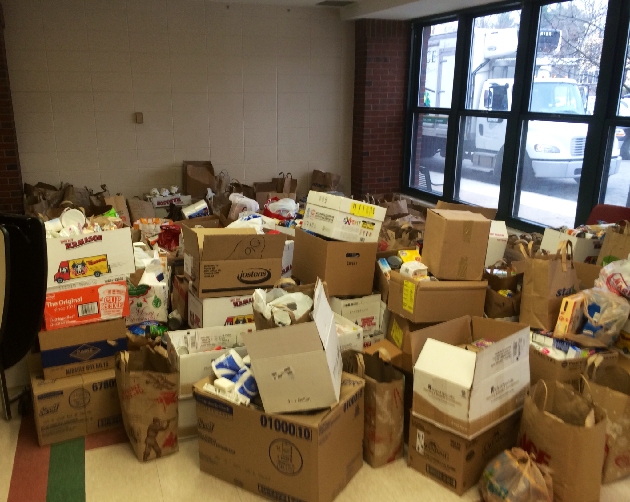 Pantry donations stacked in cafeteria